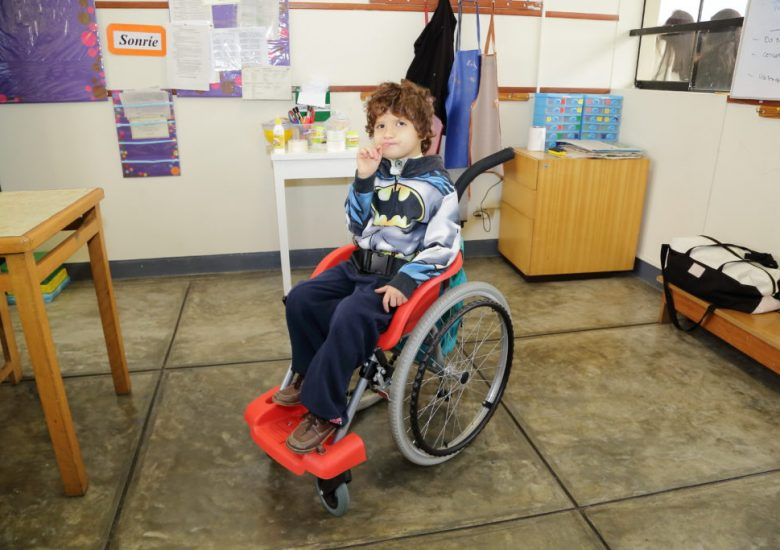 Child sits in wheelchair of hope